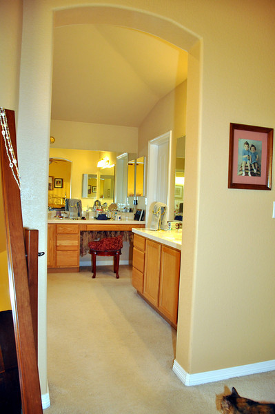 """This is the first of the """"before"""" photos. Since we moved in (2000), about all we've done to the master bathroom is paint the walls and add window coverings. The """"after"""" photos follow all """"before"""" photos. That's the inspector, in the lower right."""