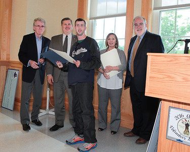 Joe Curley receives citation for his many hours volunteering in the Plymouth Center for Active Living kitchen. Wicked Local Photo/Denise Maccaferri