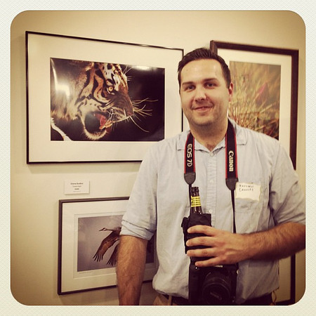 Matthew posing with his photo, Niiice Kitty..., at Gallery 7