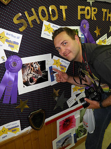 Matthew posing with his photo, Niiice Kitty..., at the Sandwich Fair