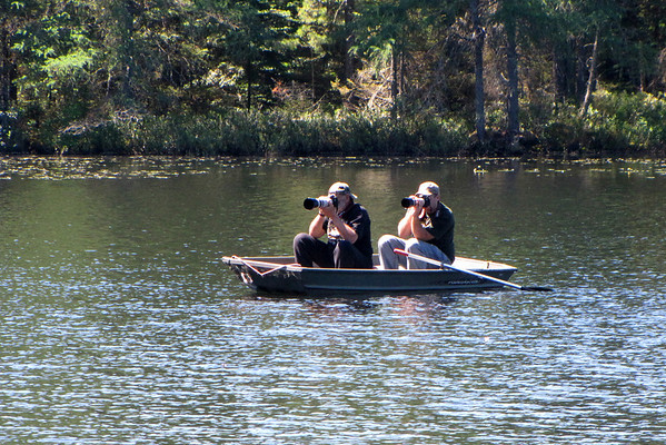 Matthew and his dad stalking wildlife in a Jon Boat