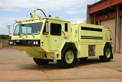 A reserve crash truck for both airports - Kahului and Kapalua.  The day of my visit this 1986 Oshkosh P-19  1000/1000/130 was in service at Kahului Airport as a result of Rescue 1 (a 2007 Oshkosh Striker 1500 crash truck) out of service.  Normally, the 1986 Oshkosh is kept at the smaller Kapalua Airport.