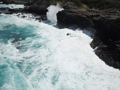 Offshore shot of waves actively eroding volcanic rock.  North Shore, West Maui