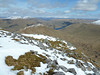 Snow covered Caingorms in the far distance over Loch Lyon from the summit of Creag Mhor - 12th May 2012