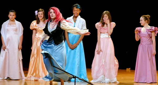 "Ariel (Kaitlyn Malone) is laughed at by the princesses as she tries to dance to impress Prince Eric  in Highland Middle School's production of Disney's ""The Little Mermaid Jr."""