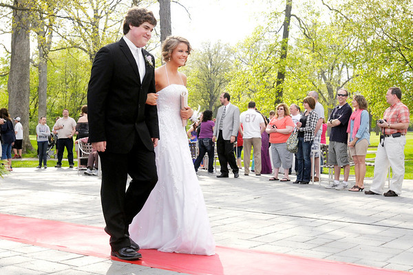 Rachael Cowin and Jacob Huff are introduced as they walk the red carpet during Liberty Christian's banquet at the Anderson Country Club on Saturday.