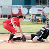 Frankton's Shelby Hulse tags Winchester's Becca Neville out at third as the Eagles faced Winchester in the second round of the softball sectional at Frankton on Tuesday.