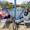 With the bright sunshine and temperatures in the mid-70's Diane Bodenhorn, her daughter-in-law Amanda Maddox, and grandson Colton Maddox, 12, found the pedestrian bridge over White River downtown the perfect spot to enjoy the spring afternoon.