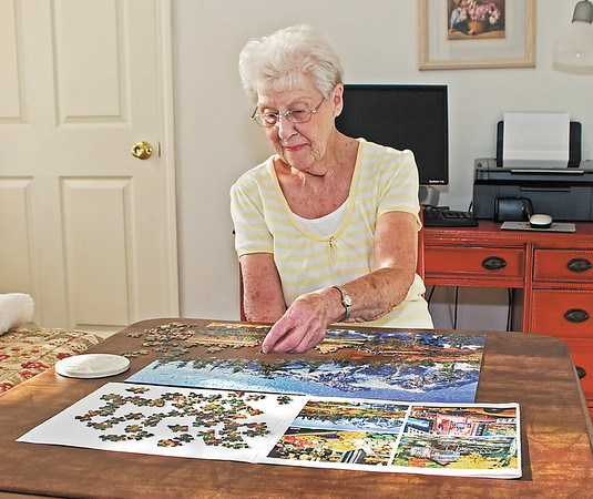 Martha Passwater gets some mental exercise by working on a picture puzzle; she will be 90 on May 27.