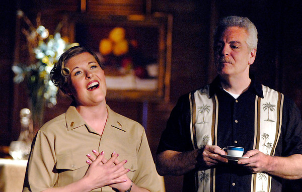 """ENS. Nellie Forbush (Jessica Cookston), falls in love with Frenchman Emile de Becque (Rick Purvis), in the Mainstage production of the musical """"South Pacific."""""""