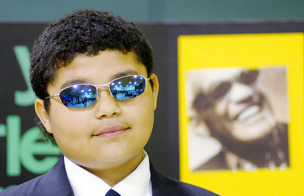 Kevin Booker, 11,  portrays Ray Charles as fifth graders from Edgewood Elementary held a living history museum on Thursday. Students spent the last month researching biographies. The project culminated in the living history museum. To purchase this photo or other photos produced by The Herald Bulletin staff, visit heraldbulletin.smugmug.com.