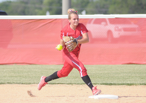 Frankton's Natalie McGuire steps on second to force out a base runner before throwing to first to turn a double play as the Eagles faced Winchester in the second round of softball sectional at Frankton on Tuesday.