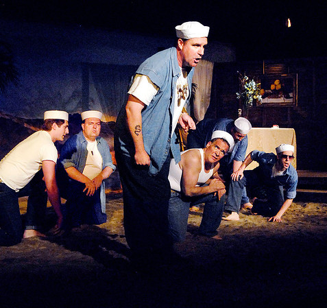 """Seabee Luther Billis (Andrew Persinger) leads his fellow sailors in song in the Mainstage production of the musical """"South Pacific."""""""