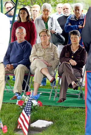A memorial for Matthew Smith, a Marine who was killed in action 10 years ago, was held Friday At Memorial Park Cemetery by fellow Marines who had served with Smith.  Matthew's father David Smith, aunt Vickie Buck, and mother Patricia Smith sit and listen to the speakers during the memorial.