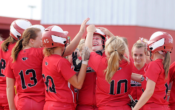 Frankton celebrates Kaylee Irwin's two run homerun in the bottom of the third as the Eagles faced Winchester in the second round of the softball sectional at Frankton on Tuesday.