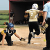 Lapel's Alicia Sprague tags home plate as Shenandoah's catcher Taylor Goyette tries to tag her on the legs but the ball came loose on contact making Sprague safe.