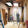 Workers continue to work on remodeling a suite in the Union Building that will be the new home of the Madison County Chamber. Eleven local companies have donated goods and services to do the work.