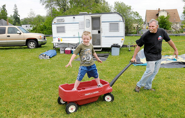 Ron Leonard plays with his grandson Cash, 4, at their campsite at the Anderson Speedway. This is Leonard's 43rd Little 500.
