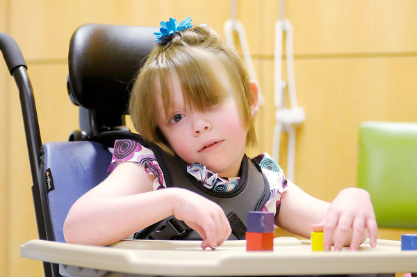 Haleigh McCue, 6, stacks blocks as she works with occupational therapist Kimberly Biberstein at St.Vincent Anderson Regional Hospital's Carl D. Erskine Rehabilitation Center on Friday.