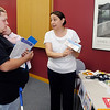 Rebecca Mader and her 3 month old daughter Jodi Judd listen to Health Specialist for Head Start Esperanza Igram during the Wellness & Resource Fair held Friday at Hopewell Center in Anderson.