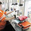 Taylor Hinkle, 19, pours a frosty mug of root beer at Gene's Root Beer in Anderson on Tuesday.