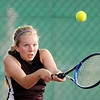 Alexandria's Sarah Kate-Brennan returns a volley during the sectional tennis championship between the Tigers and Pendleton Heights Arabians at Highland Middle School on Friday.