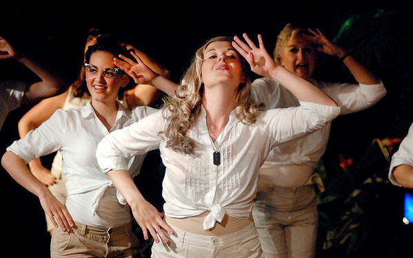 """ENS. Nellie Forbush (Jessica Cookston), sings and dances with her fellow nurses in the Mainstage production of the musical """"South Pacific."""""""