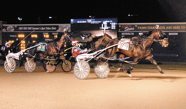 Bolt the Duer, driven by Sam Widger, crosses the finish line ahead of Fred and Ginger and Rockincam to claim the 20th running of the Dan Patch Invitational Saturday night at Hoosier Park.