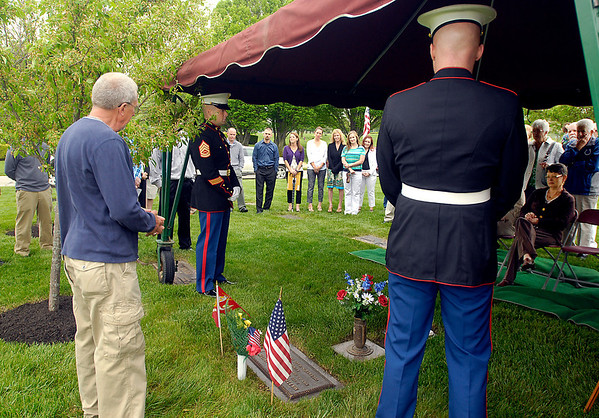 David Smith speaks to those gathered at a memorial for his son Matthew Smith, a Marine who was killed in action 10 years ago,  Friday At Memorial Park Cemetery. Fellow Marines who had served with Smith organized the memorial.