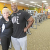 Anytime Fitness owner Lillian Albert poses for a photo with professional body builder Ed Nunn. Nunn works out at Anytime Fitness in the Applewood Centre.