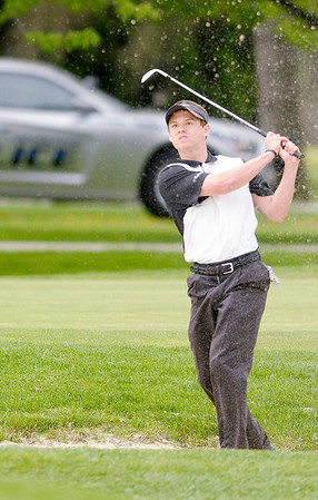 Lapel's Tanner Watkins watches his shot from the bunker into the seventh green during the  Madison County golf tournament on Saturday at Edgewood.
