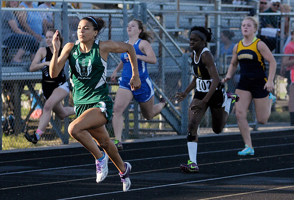 Pendleton Heights' Kiawna Cottrell wins the 100 meter dash during the Girls Track Sectional at Pendleton Heights on Tuesday.