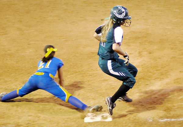 Pendleton Heights' Delilah Wright beats the throw to first after bunting the ball as the  faced Greenfield-Central for the sectional championship on Wednesday.