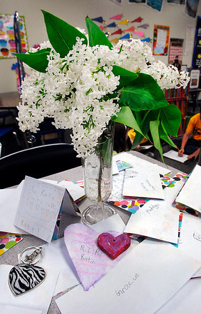 Katie Kline's desk in Amy Scheib's Daleville Elementary School 2nd grade classroom sits covered with cards and flowers from her classmates Monday after katie passed away of cancer over the weekend.