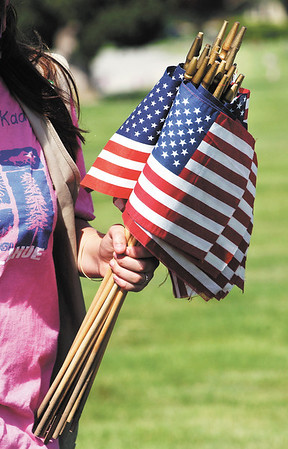 The Girl Scouts place more then 3,000 American flags on veterans graves that are buried in Anderson Memorial Park Cemetery.
