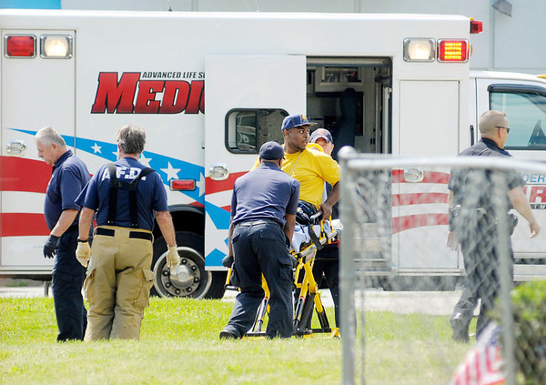 A patient is loaded into an ambulance as APD and AFD respond to a shooting on Nichol Avenue just east of Arrow Avenue on Wednesday afternoon.