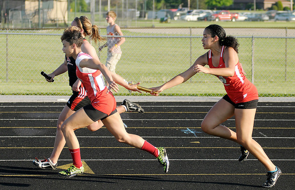 Anderson's Pearson Newsom hands off to Darien Thompson in the 4x100 meter relay during the Girls Track Sectional at Pendleton Heights on Tuesday.