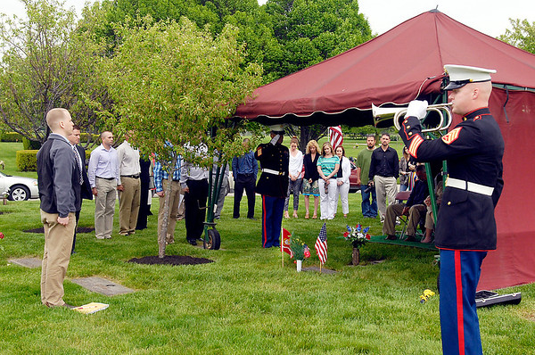 A memorial for Matthew Smith, a Marine who was killed in action 10 years ago, was held Friday At Memorial Park Cemetery by fellow Marines who had served with Smith.
