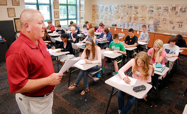 Pendleton Middle School 8th grade teacher Brice Higginbottom gives a quiz to his social studies class Wednesday afternoon.  The Pendleton Middle School was just named a 4-star school.