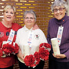 From left, Fay Stowe, Vickie Robb and Emilie Isenhour hold poppies at the American Legion in Anderson. The poppies are crafted by veterans at the VA facility in West Lafayette and the American Legion Auxiliary will be asking for donations in exchange for poppies on the 18th and 19th at the Wal-Mart in Anderson.