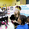 Brooklyn Rudicil, 11, portrays Queen Elizabeth I as fifth graders from Edgewood Elementary held a living history museum on Thursday. Students spent the last month researching biographies. The project culminated in the living history museum. To purchase this photo or other photos produced by The Herald Bulletin staff, visit heraldbulletin.smugmug.com.