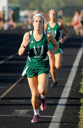 Pendleton Heights' Maddi Hinton leads the 1600 meter run during the Girls Track Sectional at Pendleton Heights on Tuesday. Hinton won with a time of 5:34.52.