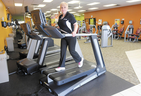 Anytime Fitness owner Lillian Albert demonstrates the Nautilus Tread Climber. Anytime in the Applewood Centre has recently overhauled and expanded their facilities.