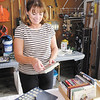 Ginnie Clevenger prices items as she prepares for Pendle Hill's annual neighborhood garage sale on Friday.