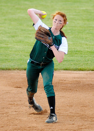 Pendleton Heights' Sarah Dixon throws to first after fielding the balls as the Arabians faced Greenfield-Central for the sectional championship on Wednesday.