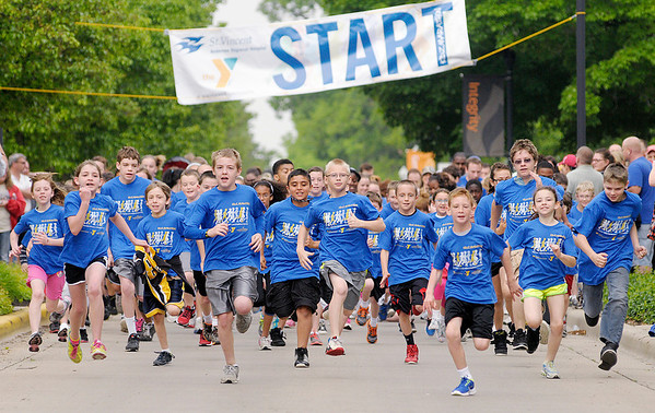 Runners take off from the start of the Kidz Marathon on the campus of Anderson University sponsored by the YMCA and St. Vincent Anderson on Saturday. This is the third year for the event.