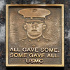 A memorial for Matthew Smith, a Marine who was killed in action 10 years ago, was held Friday At Memorial Park Cemetery by fellow Marines who had served with Smith.  They had this bronze plaque made with Matthew's photo on it and placed next to his grave marker.