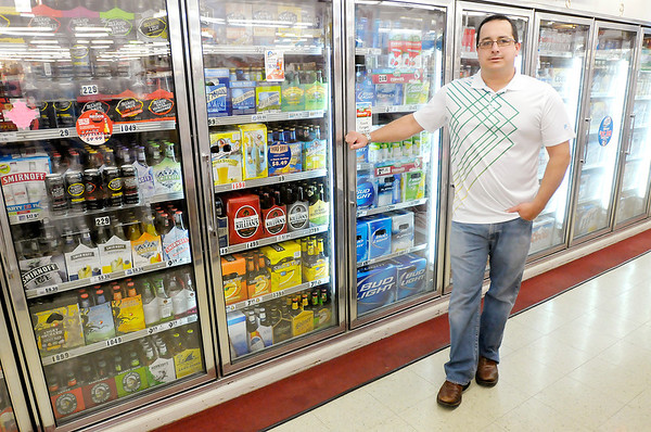 Keg 'n Bottle owner Joel Hackleman says cold beer sales at convenience stores would severely impact his business. Convenience stores are taking the state to court challenging restrictions that keep them from selling cold beer.