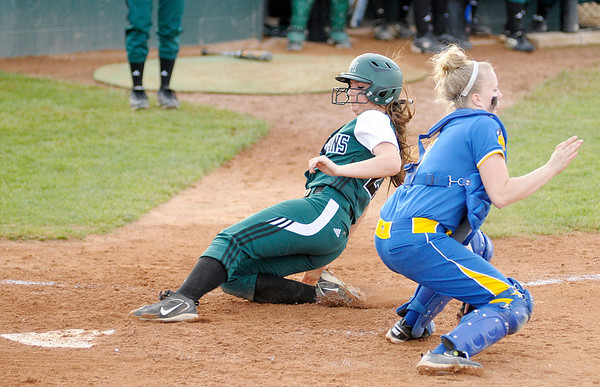 Pendleton Heights' Kyndall Dishroon beats the throw to home plate as she is batted in by Sydney Windlan as the Arabians faced Greenfield-Central for the sectional championship on Wednesday.