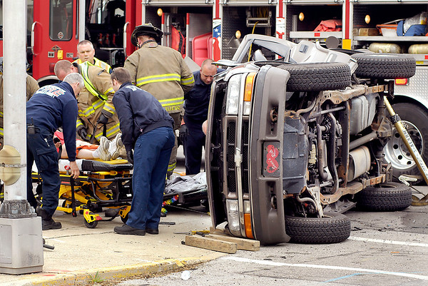 Anderson Fire Department personnel load up this woman after freeing her from her SUV that had rolled after being involved in a 2-vehicle crash Saturday afternoon at 13th and Jackson Street.